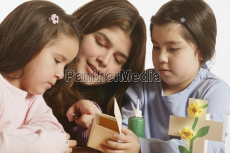 two young girls being instucted on