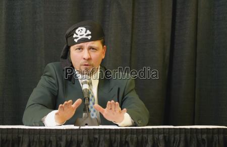 speaker wearing pirate headgear