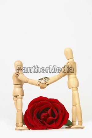 two mannequins shaking hands with wedding