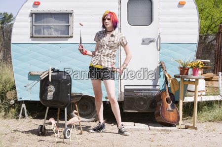 girl in front of a trailer