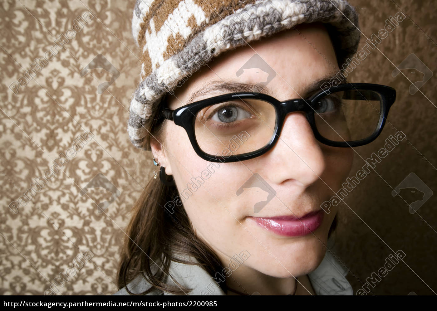 nerdy, woman, in, a, knit, cap - 2200985