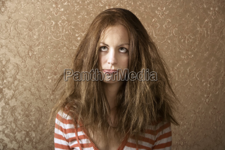 young woman with messy hair
