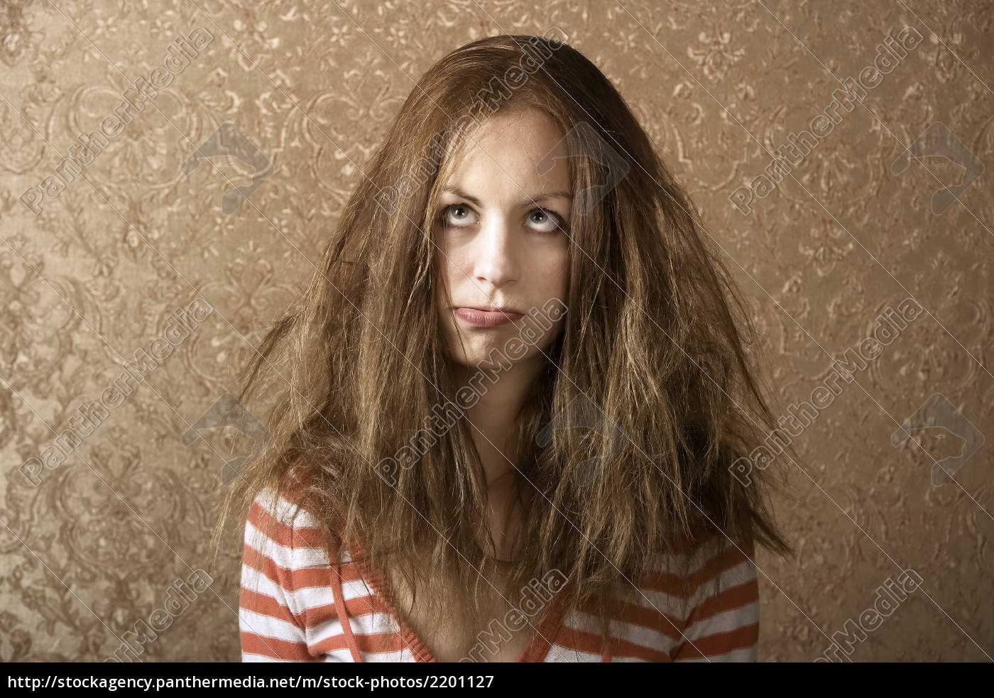 young, woman, with, messy, hair - 2201127