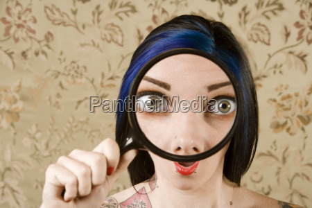 pretty woman with a magnifying glass