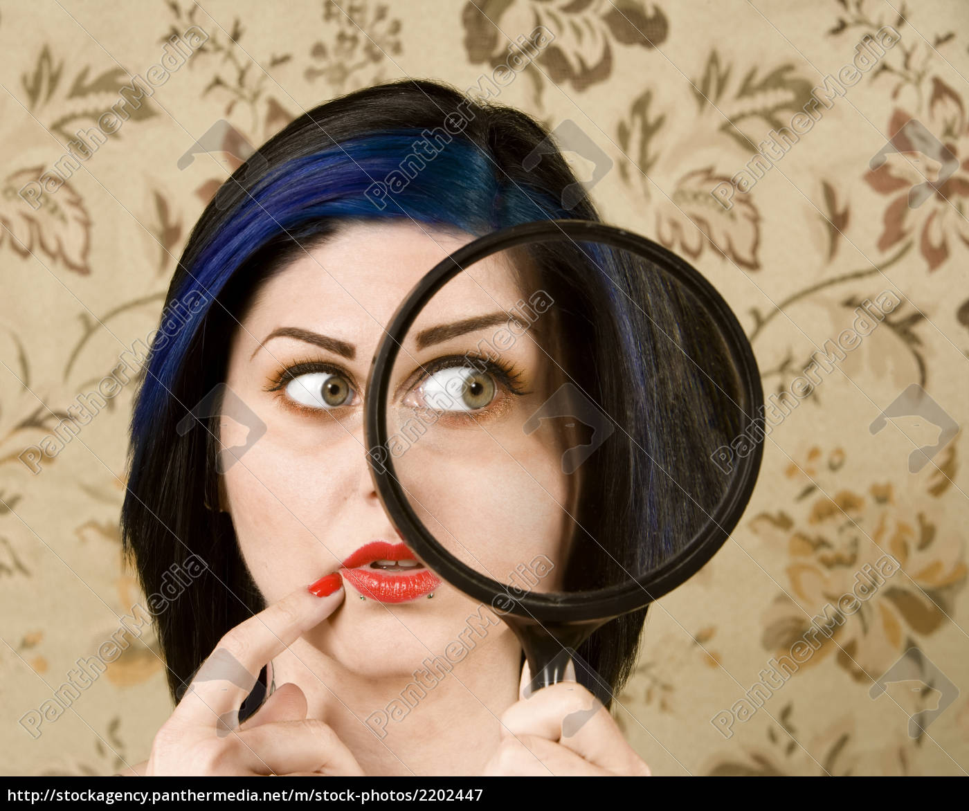 pretty, woman, with, a, magnifying, glass - 2202447