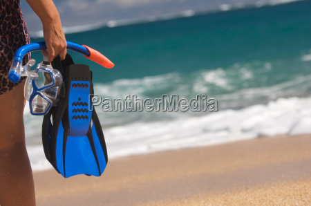 woman holding snorkeling gear on the