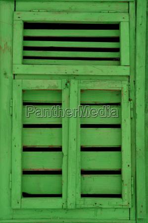 a rustic green wooden door sighet