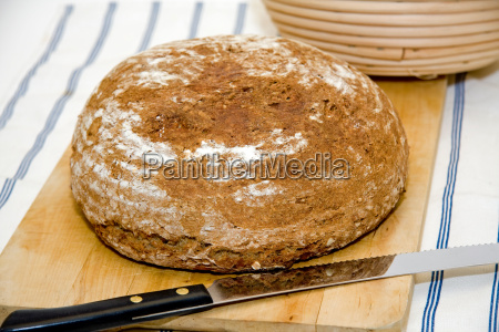 bread loaf on vesper board with
