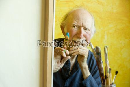 artist at a canvas