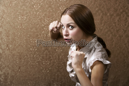 young woman throwing a punch