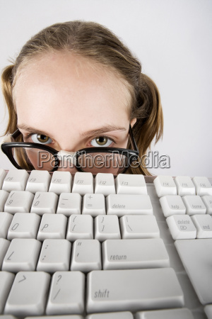 young nerdy girl with a keyboard