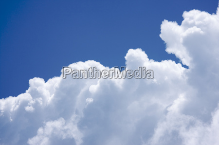 white cumulus clouds off the coast