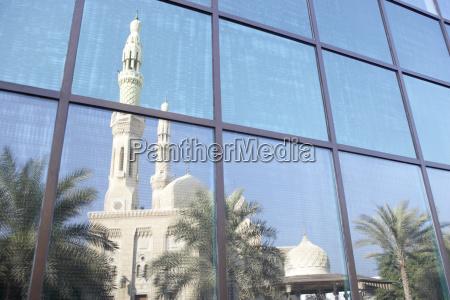 dubai jumeirah mosque reflected in modern
