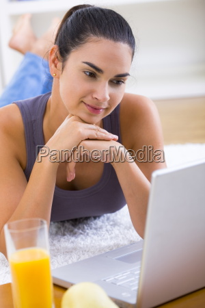 smiling woman working on laptop computer