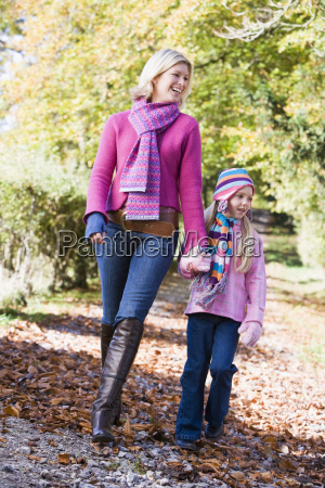 woman and young girl walking outdoors