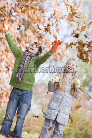 two young children outdoors in park