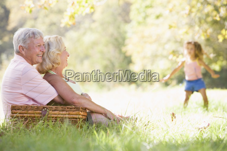 grandparents at a picnic with young