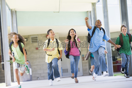 six students running away from front
