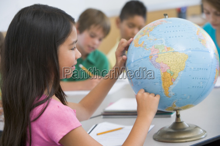 student in class pointing at a