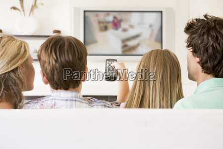 family in living room with remote