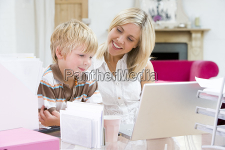 woman and young boy in home