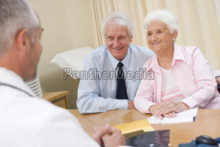 couple in doctors office smiling