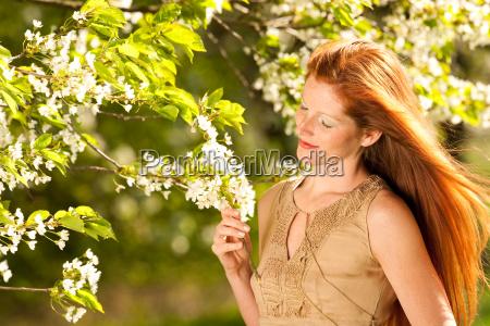 summer woman blossom tree park