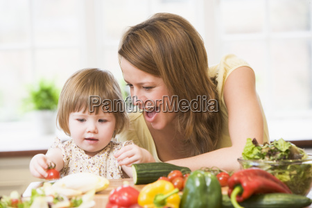 mother and daughter in kitchen making
