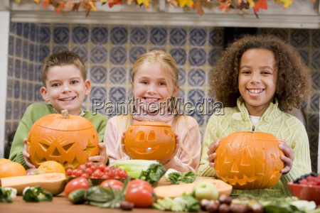three young friends on halloween with