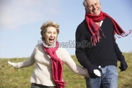 senior couple running in the park
