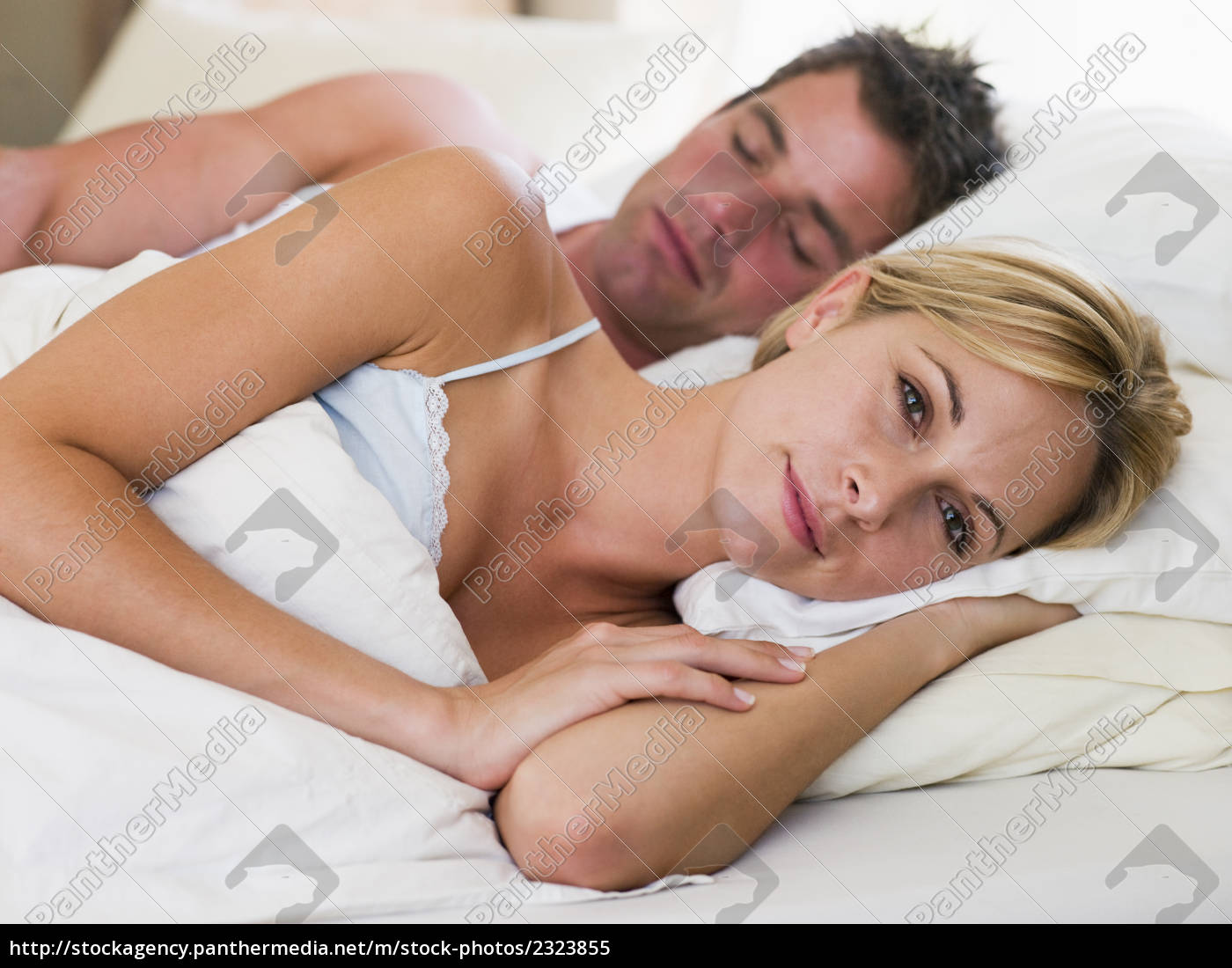 couple, lying, in, bed, with, the - 2323855
