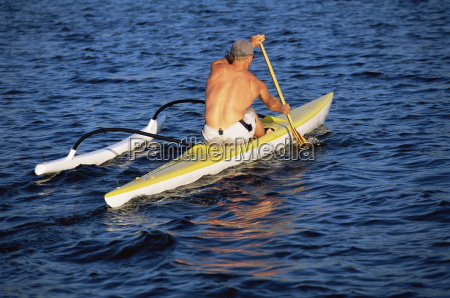 kayaker outdoors rowing in calm water