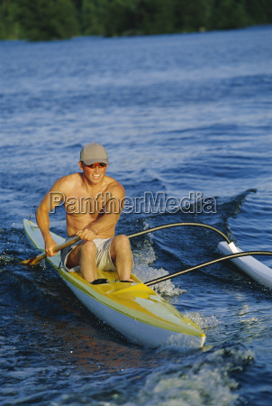 kayaker rowing in calm waters selective