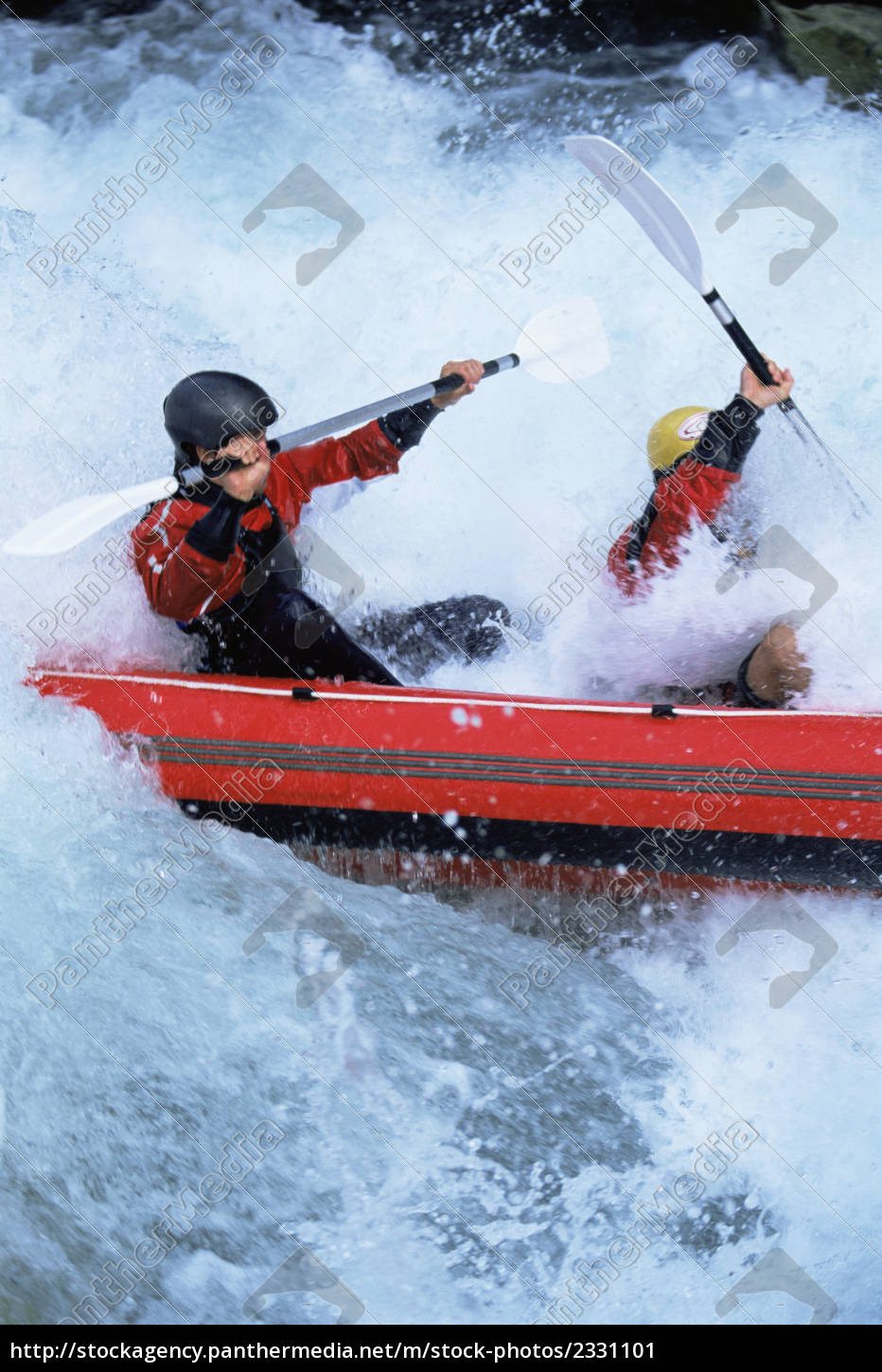 two, kayakers, rowing, in, rapids - 2331101