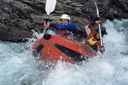 two, kayakers, rowing, in, rapids - 2331107