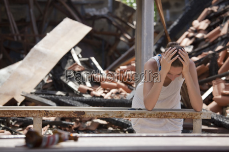 sad, woman, in, front, of, burning - 2378289