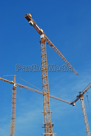three construction cranes