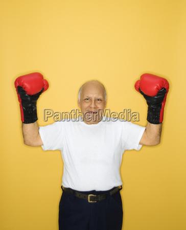 man wearing boxing gloves