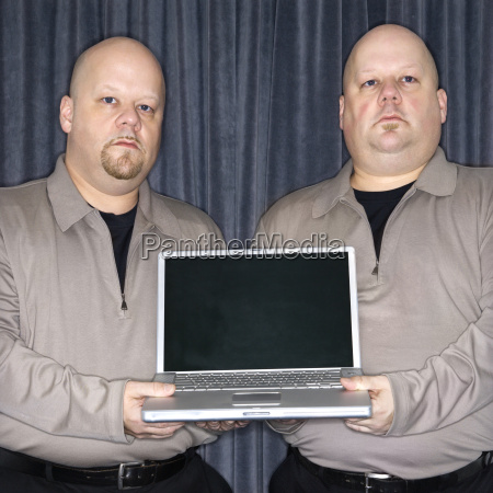 twins with laptop