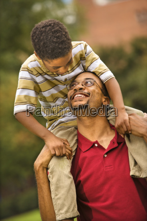 father carrying son