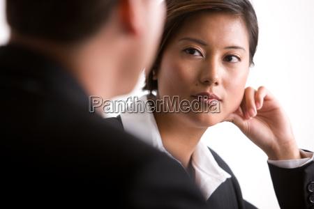 businesswoman watching colleague