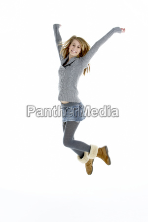 full length portrait of jumping teenage