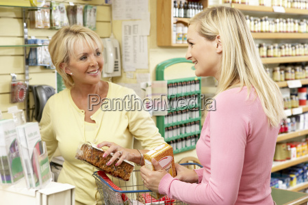sales assistant with customer in health