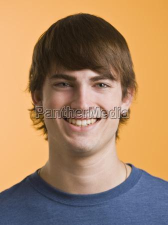 brunette male smiling