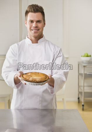 attractive male with pie