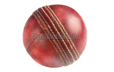 an old used red cricket ball