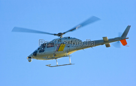 flying helicopter in blue sky