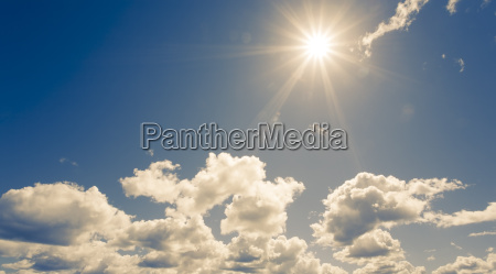 bright sun on blue sky with