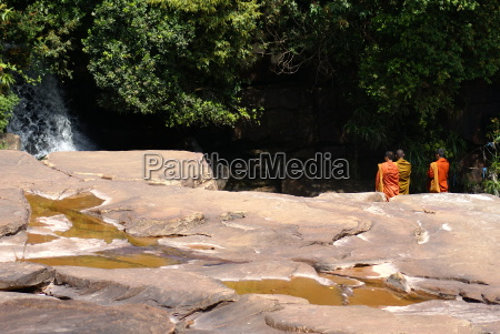 monks at waterfall