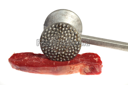 raw steak and meat tenderizer isolated